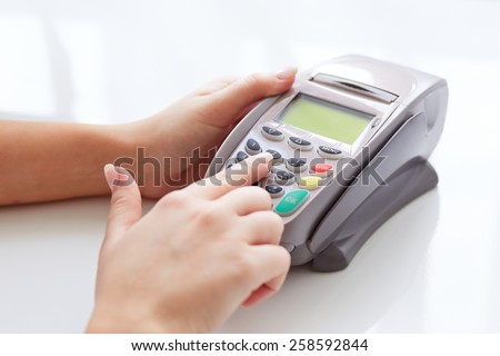Woman pay by credit card in store - stock photo