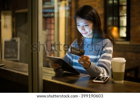 Woman pay credit card on tablet pc