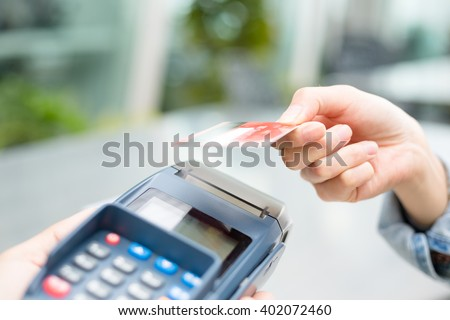 Woman pay with credit card - stock photo