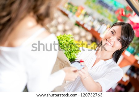 Woman paying at the supermarket with credit card