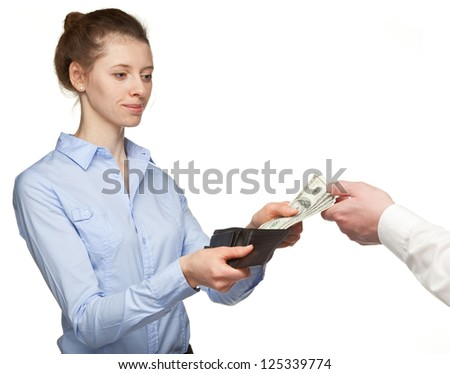 Woman paying money from a wallet - closeup shot - stock photo