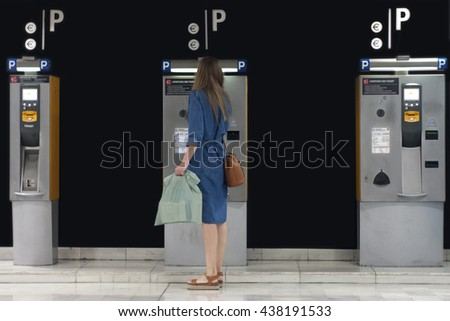 Woman paying on park meter