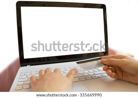woman paying wiht the credit card online - stock photo