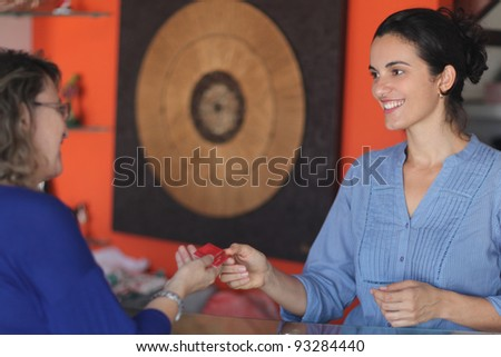 woman paying with credit card - stock photo