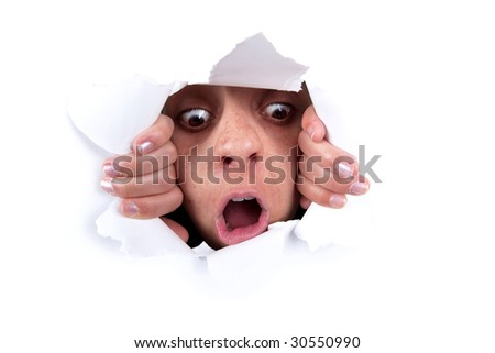 woman peeking behind white wall hole