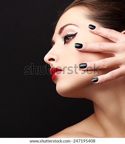 Woman perfect makeup profile with black nails polish on black background. Closeup portrait