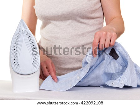 Woman petting a shirt steam iron  on white background.