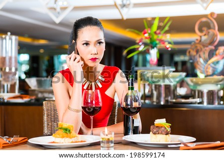 Woman phoning in restaurant