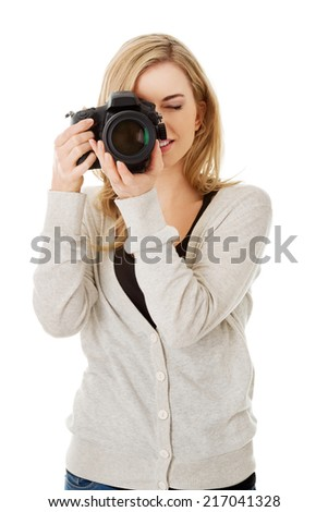 Woman photographer at work with DSLR - stock photo