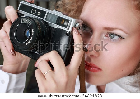 woman photographer holding camera