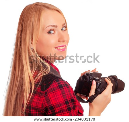 Woman photographer is turning around while she is shooting - isolated on white - stock photo