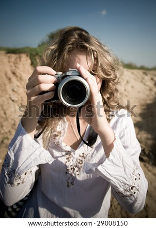 Woman photographer. Low saturated colors effect. - stock photo