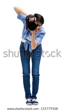 Woman-photographer takes shots, isolated on a white background - stock photo