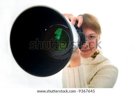 woman photographer with big objective lens on white background