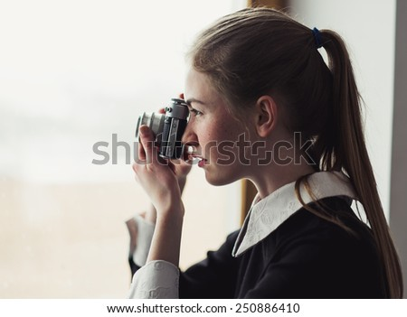 woman photographer with film camera - stock photo