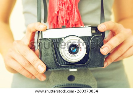 Woman photographer with old lomo camera. - stock photo