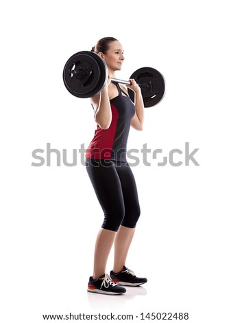 Woman pick up weight  on barbell, isolated over white background - stock photo