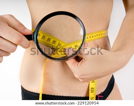 Woman pinches her fat - stock photo