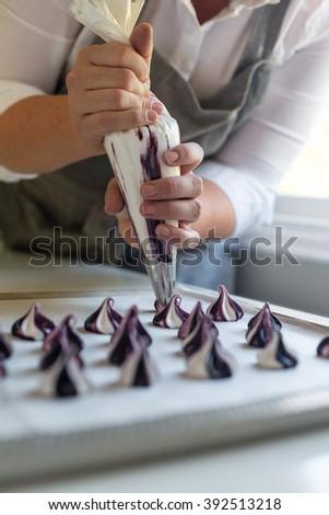 woman pipes meringue - stock photo
