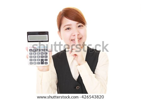 Woman placing finger on lips. - stock photo