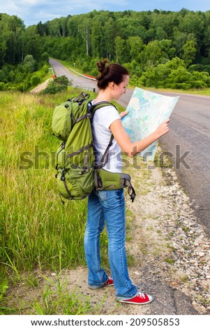 Woman planning a trip with a map