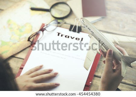 Woman planning on travel,different  travel  items.