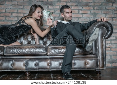 woman play the sexy part to push her boyfriend to give her money - stock photo