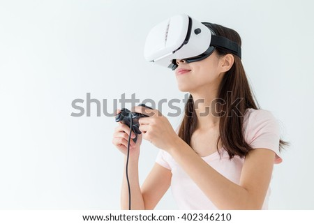 Woman play video game with joystick with VR device - stock photo