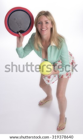Woman playing an indoor tennis like game to keep fit