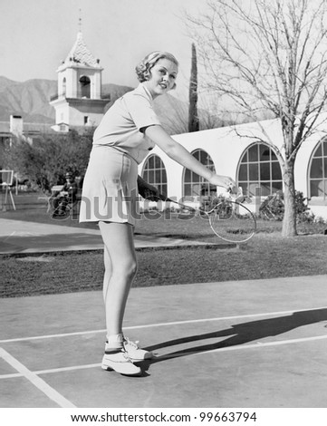 Woman playing badminton - stock photo