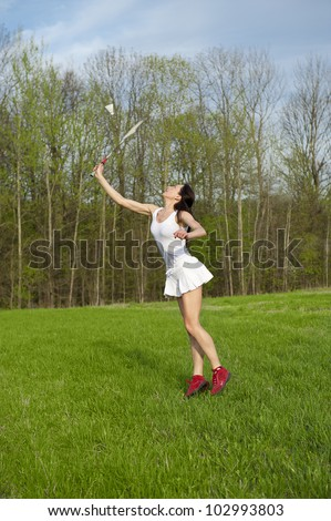 Woman playing badminton game in the park