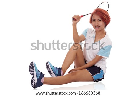 Woman playing badminton on a white background.