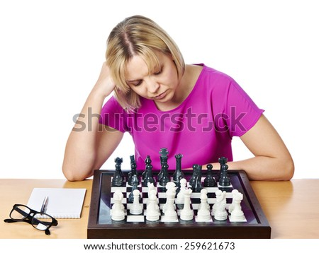 Woman playing chess isolated on white