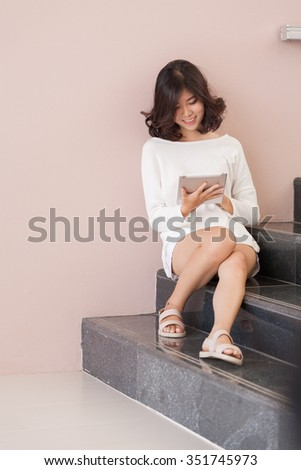 woman playing game on tablet computer