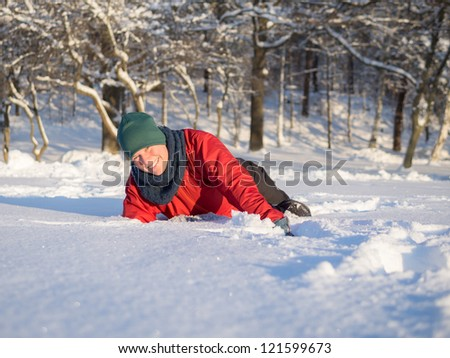 Woman playing in powder snow