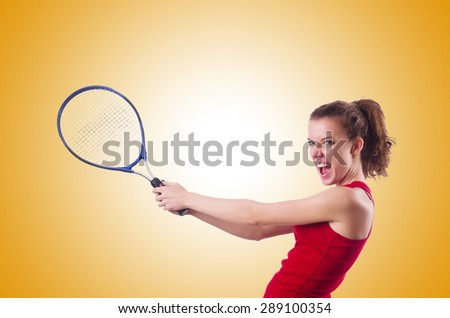 Woman playing tennis against the gradient