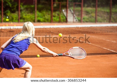 Woman playing tennis and preparing for sports competition. Professional athlete in a form proves the equality of women over men. - stock photo