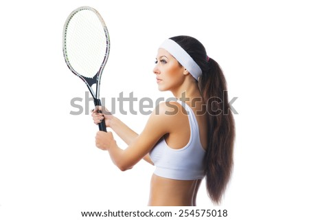 Woman playing tennis and waiting for the service. Isolated over white background. Side view - stock photo