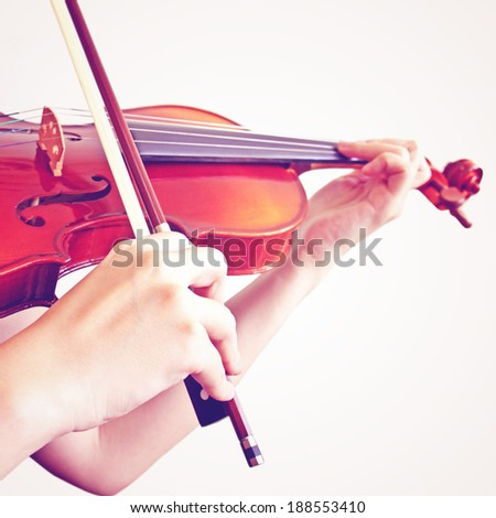 woman playing violin with retro filter effect - stock photo