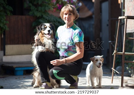 Woman playing with dog outdoors