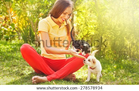 woman playing with her can and dog outdoors - stock photo