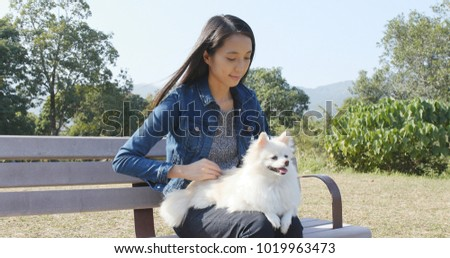 Woman playing with her dog at outdoor
