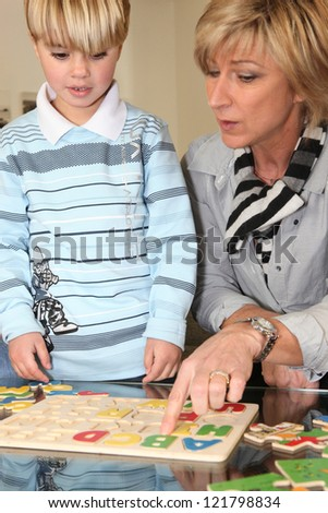 Woman playing with her grandson - stock photo