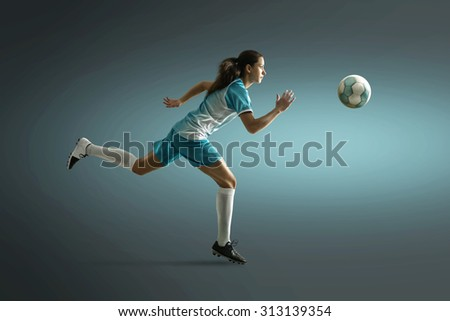 Woman plays soccer - stock photo