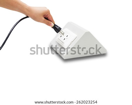 Woman plugging cable to the electric outlet