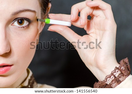 Woman plugging USB flash memory stick to her head closeup portrait - stock photo