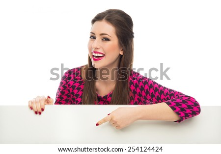 Woman pointing at blank sign  - stock photo