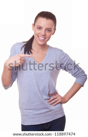 woman pointing her finger aside on white background - stock photo