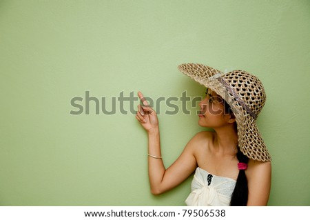 Woman Pointing on green background