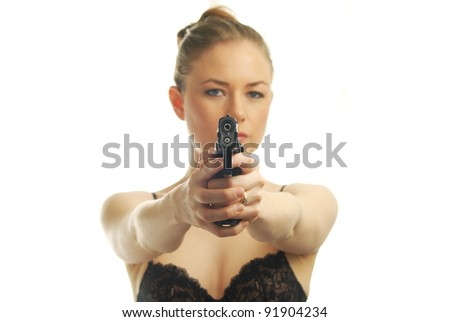 woman pointing pistol - stock photo